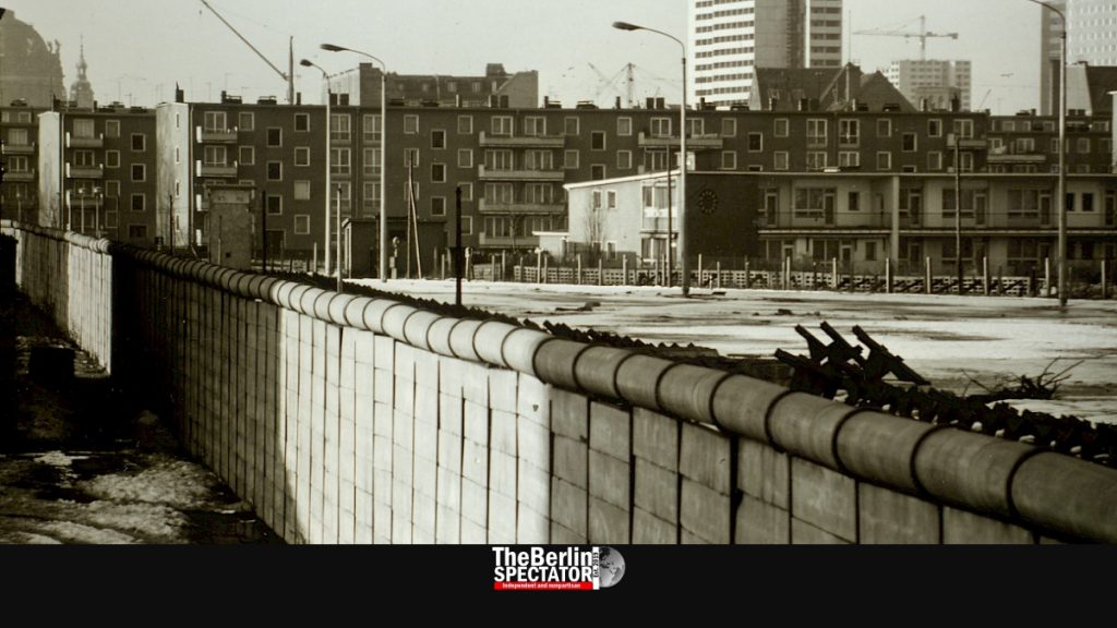 The Berlin Wall cuts through Berlin like a knife.