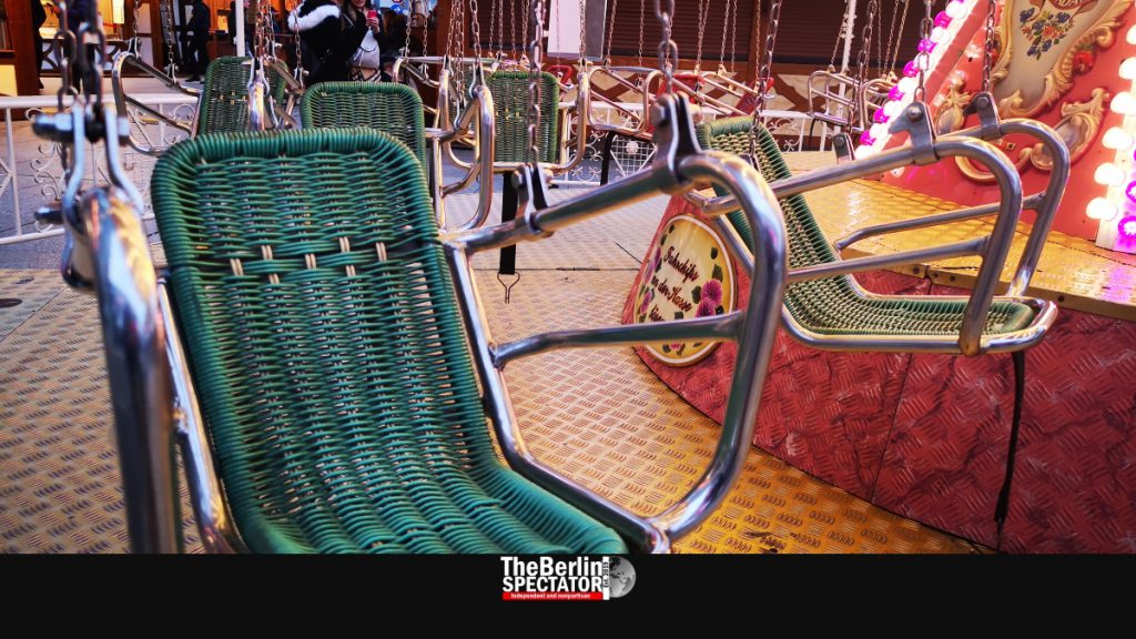 An empty swing carousel is waiting for kids at 'Winter World'.