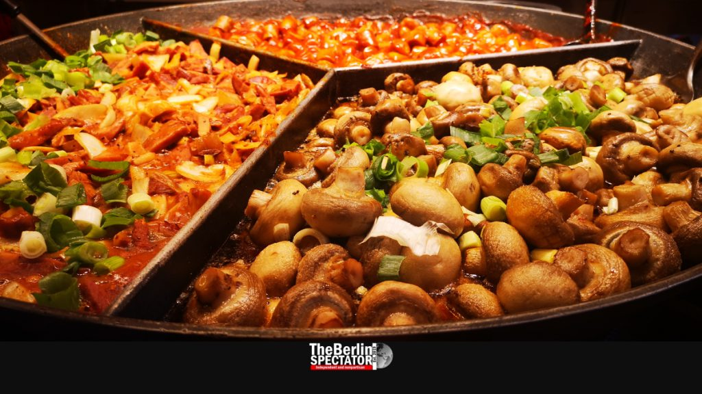 Loads of mushrooms and veggies in a big pan at 'Winter World' are waiting to be consumed.